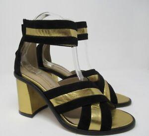 daf4f80db89 New! BCBGMAXAZRIA Cross Strap Black Gold Block Heel Sandal Size  39 ...