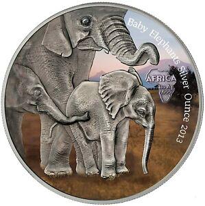 Gabun-1000-Francs-2013-Baby-Elephants-Silver-Ounce-Antique-Finish-in-Farbe