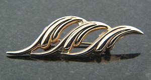 14k-Yellow-Gold-Large-broach-pin-modern-wave-design