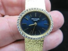 PATEK PHILIPPE~A LADY'S FINE 18K YELLOW GOLD AND DIAMOND-SET OVAL BRACELET WATCH