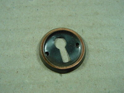 rund aus Metall verkupfert. Schlüssellochblende,Möbelbeschlag,Schlüsselloch