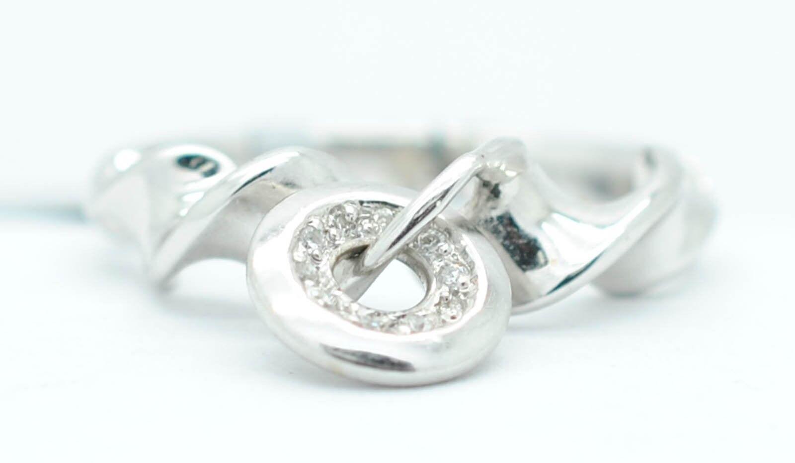14K White gold 12 Point Diamonds G-SI1 Swirl Ring