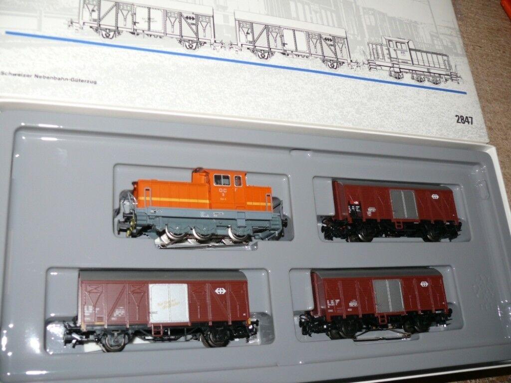 S50 Märklin 2847 suizos junto a Ferrocarril Tren de Carga