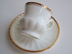 Details about Vintage Queen Anne Bone China India Tea Cup Saucer White Gold  Footed Grooved