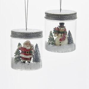C6707 Kurt Adler Set/2 Snowman Santa Claus Christmas Scene in Mason Jar Ornament