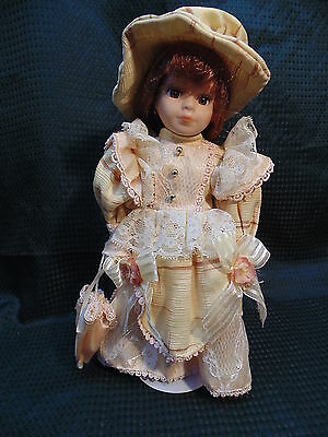 "Pretty Doll Victorian 12"" Porcelain/ Cloth Doll w/ matching Hat & Parasol"