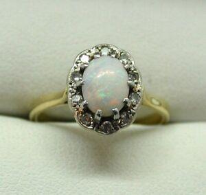 Beautiful-18-Carat-Gold-Opal-And-Diamond-Ring-Size-O