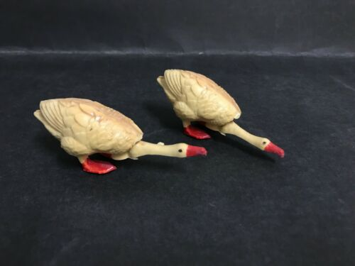VINTAGE TOY CELLULOID TYPE PLASTIC HEAD NODDER X2 DUCKSGEESE FROM 1950's
