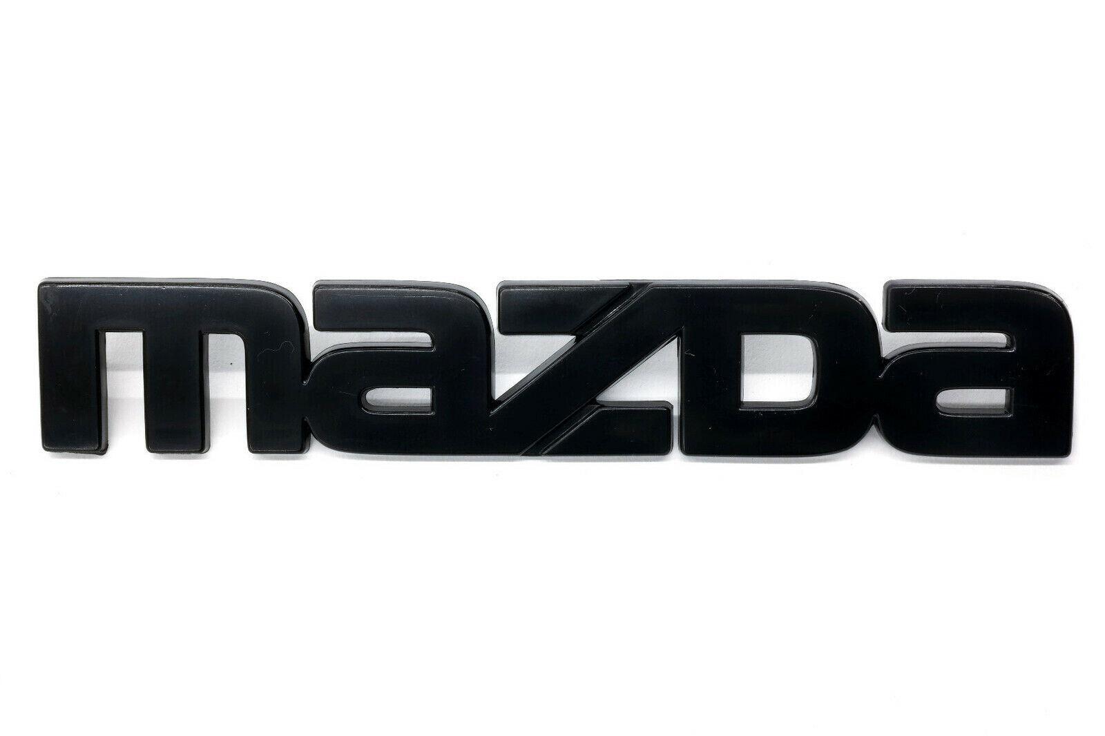 New OEM Mazda RX-7 1984-1985 Front Mazda Emblem Black F023-51-770A