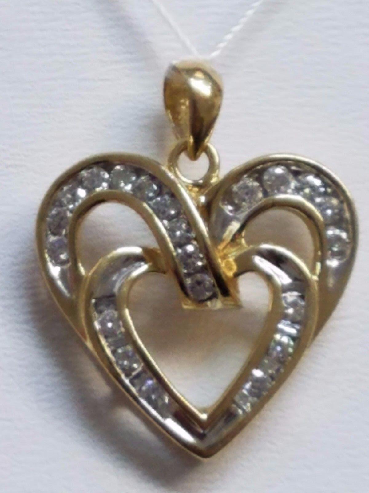 14 KARAT YELLOW gold DIAMOND HEART PENDANT , 3.8 GRAMS