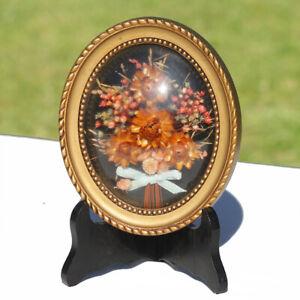 Cadre doré verre bombé rond bouquet de fleurs séchées fond noir vintage 18 cm