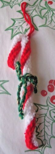A HAND KNITTED XMAS TREE DECORATION SUGAR CANE 6 INCHES LONG.