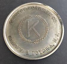 KENNEDY MORTGAGE CO. CAMDEN & TOTOWA NJ on REVERSE of JFK 1964 HALF DOLLAR MEDAL