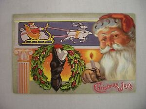 VINTAGE-EMBOSSED-CHRISTMAS-POSTCARD-SANTA-WITH-CANDLE-AND-WREATH-1910