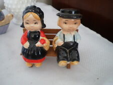 VINTAGE PORCELAIN SALT / PEPPER SHAKERS - AMISH BOY & GIRL ON WOODEN BENCH