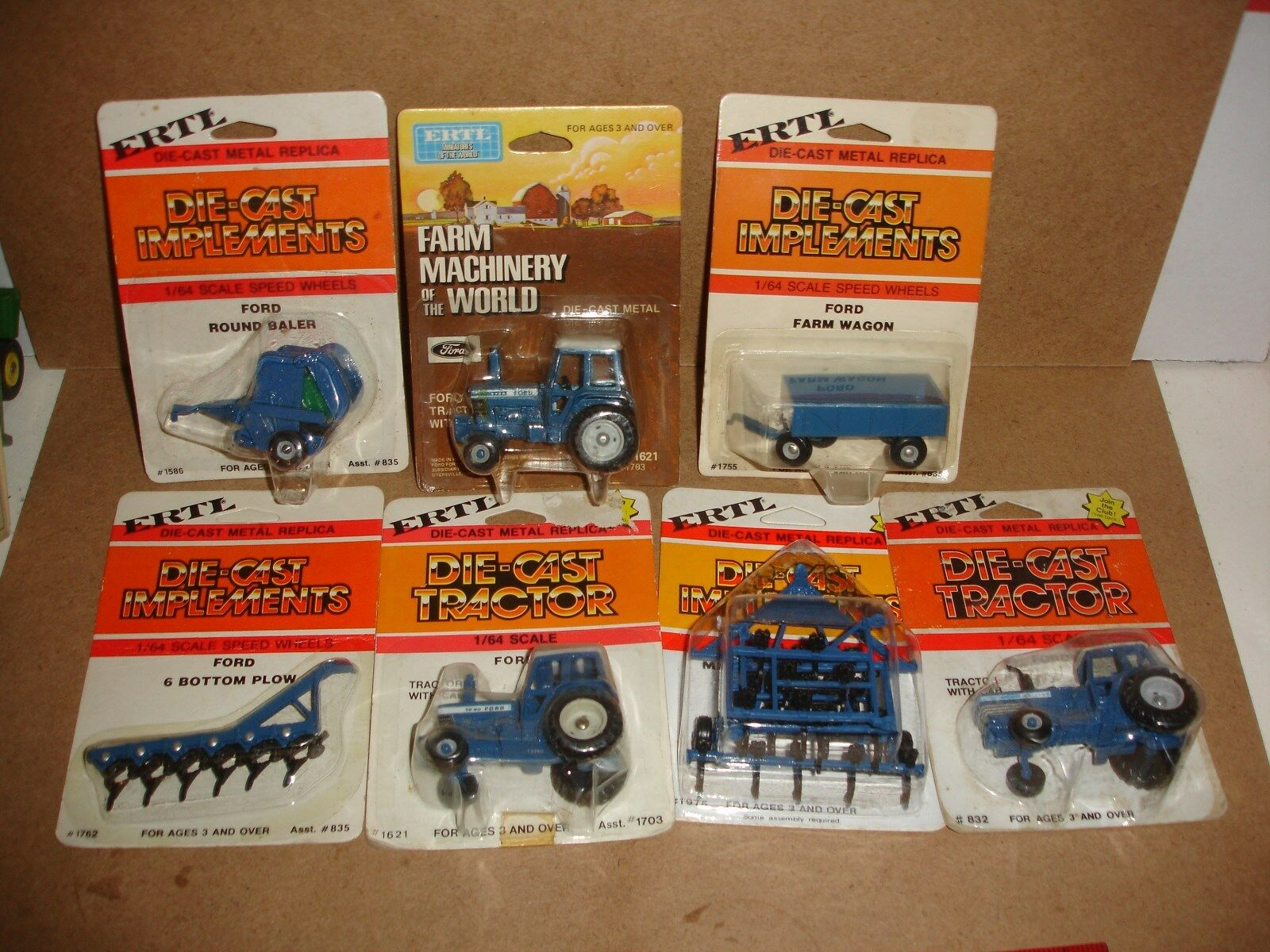 1 64 Ford Tractor & ImpleSiet Grouping - 7 pieces