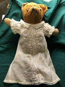 Antique-Jointed-Stuffed-Bear-with-Glass-eyes-and-in-a-vintage-dress