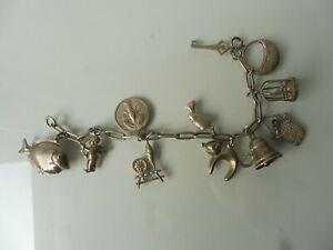 Schones-altes-Armband-Silber-Bettelarmband-mit-11-schonen-Anhanger-Charms