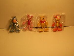 Disney Pooh,Ttigger, Eeyore, and Piglet 4-5 inches tall    Ages 3+      NIP