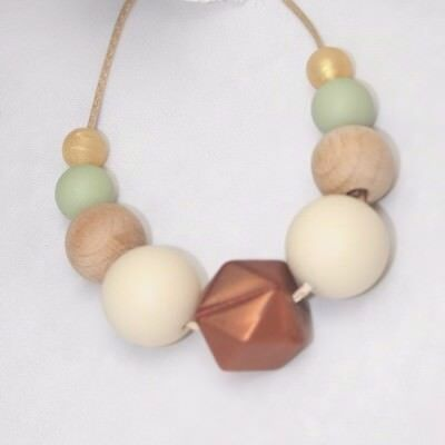 Sensory necklace was teething Brown cream wood Baby Tapuu Silicone jewellery