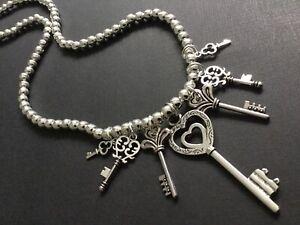 Chunky-Silver-Stretch-Beaded-necklace-With-Large-Key-Pendants-Boho-Bijoux