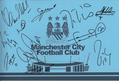A 12 x 8 inch photo personally signed by 10 Manchester City players & staff.