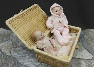 TWO-ALL-BISQUE-BABY-DOLLS-WITH-WICKER-BED