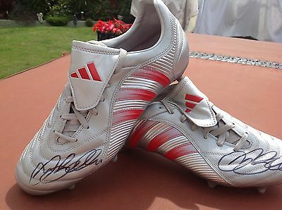 signed pair Adidas football boots