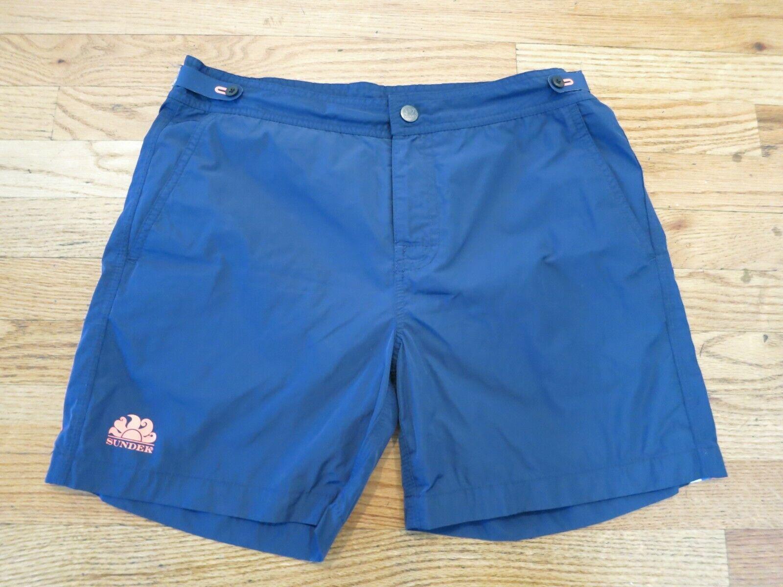 SUNDEK navy with orange and bluee rainbow waist 31