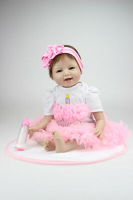 Reborn Baby Doll Soft Silicone Lifelike Smile Girl Gift for Children Pink Dress