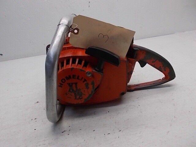 Homelite XL12 Motosierra. UT-10445B. Usada. para piezas o reparación. no en funcionamiento.