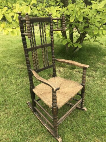 Rocking chair. Bobbin turned. Arts and Crafts, antique.