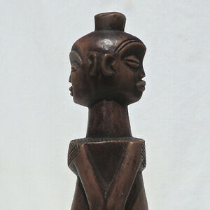 an old african janus statue figure with display base congo drc