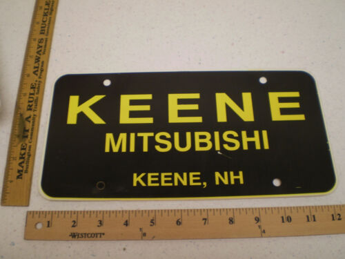 KEENE MITSUBISHI CAR DEALER NEW HAMPSHIRE PLASTIC BOOSTER FRONT LICENSE PLATE