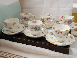 SIX  1947   CUPS AND SAUCERS BY TUSCAN CHINA  PLANTS IN BOUQUET PATTERN - <span itemprop=availableAtOrFrom>Sandbach, United Kingdom</span> - Please notify within 7 days receiving goods with reason for return, a refund including original p & p will be issued on receiving goods in original condition but any return costs includi - Sandbach, United Kingdom
