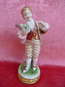 Beautiful-Old-Porcelain-Boy-With-Bird-Thuringen-Dragon