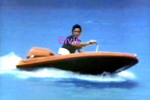 ELVIS-PRESLEY-ON-SPEED-BOAT-HAWAII-VACATION-MAY-1968-PHOTO-CANDID