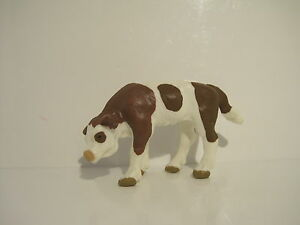 13110 Schleich Cow: Brown and White Calf, eating ref:86A48