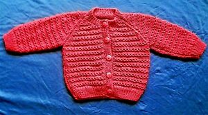 5cf57fbcd Hand knitted baby cardigan. 9-12 months. Red