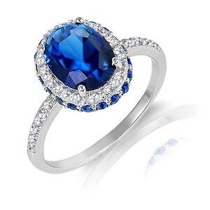 Zafiro-Azul-Ovalado-Halo-Plata-de-Ley-Anillo-de-Compromiso