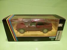SCHABAK 1525 FORD ESCORT - 5 DOORS - METALLIC RED 1:24 - NEAR MINT IN BOX