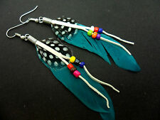 A PAIR OF LONG TEAL FEATHER & BEAD DANGLY EARRINGS.