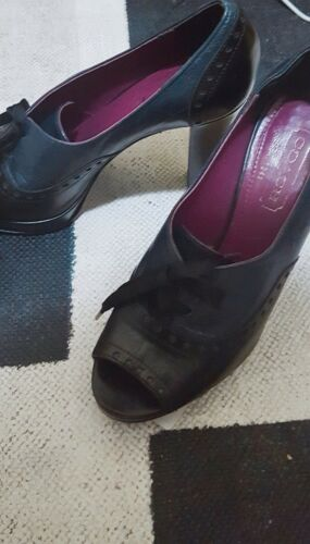 Beautiful, 30's Style Coach heels with a bow to bo