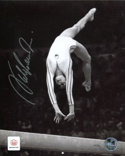 Official Olympic product: Gymnast Nadia Comaneci signed beam photo - UACC DEALER