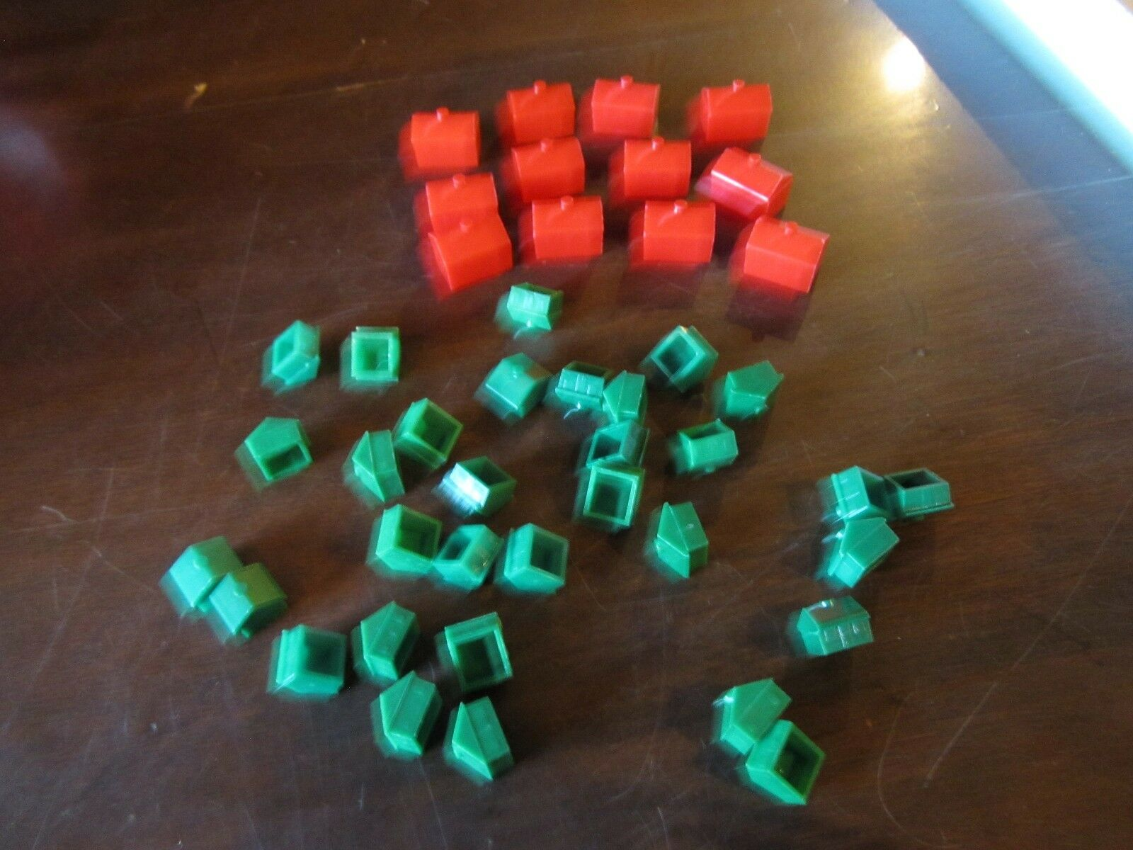 Replacement monopoly play pieces 12 red hotels and 32 green houses Parts