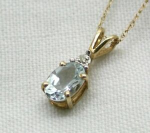 Vintage-Pretty-Dainty-9-carat-Gold-Blue-Tourmaline-And-Diamond-Pendant-And-Chain