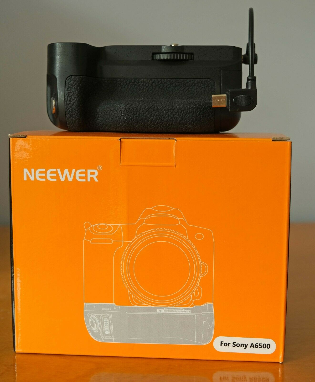 Sony A6500 Battery Grip by Neewer, specifically for this camera.