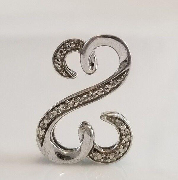 199 Kay Jewelers open heart diamond pendant by Jane Seymour.