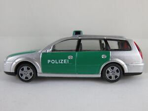 Rietze-51130-Ford-Mondeo-Turnier-2000-034-POLIZEI-034-in-silber-gruen-1-87-H0-neuw