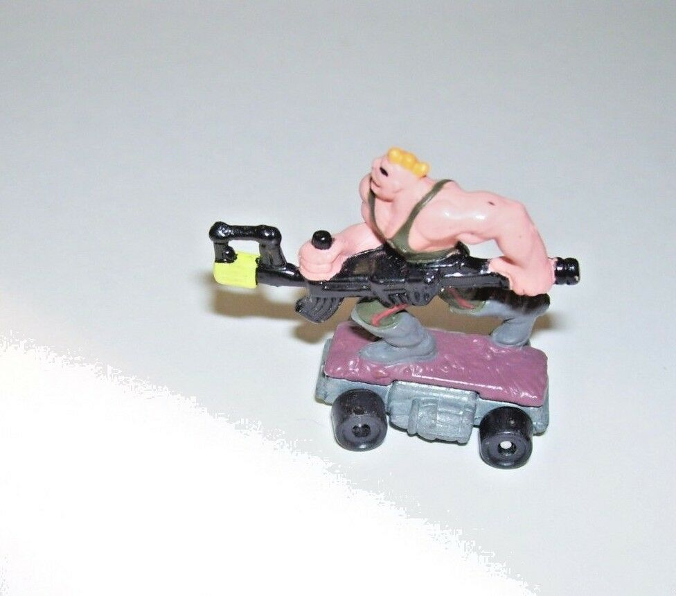 Muscle bound man with bazooka Savage Mondo Blitzers 1991 Kenner